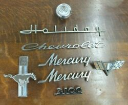 Grouping Of 8 Vintage Metal Auto Emblems And Gear Knob - Chevy - Ford - Holiday