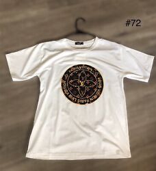 White T Shirt #72. Black Circle Orange Sign Design $6.99