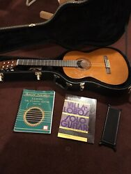 Classical Guitar With Hard Case, Extra Strings, Footstool, And Two Books