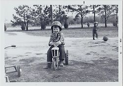 Old Vintage Photograph Little Boy Wearing Helmet Riding On Toy Tractor 1974
