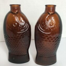 2 Vintage 1920's Amber Wheaton Glass Fish Bottle Dr. Fisch's Bitters 7.5 Tall
