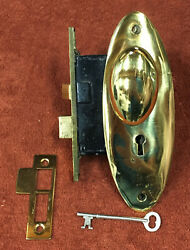 Antique Mortise Solid Brass Lock Set W/ Oval Knobs And Plates, Striker And Key