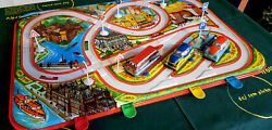 Old Tin Toy Desk Game With Original Box With Choice Of Three Wind-up Cars