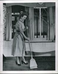 1949 Press Photo A Homemaker Sweeping Floors With A Broom