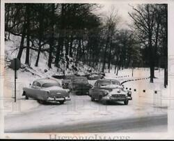 1957 Press Photo Car Skidded On Ice St Clair Cut Off From East Blvd