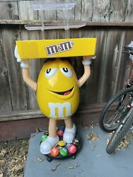 Mandm Yellow Character Candy Store Display With Storage Tray