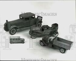 Press Photo Antique Toy Cars, Trucks And A Bus. - Hpa34627