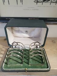 A Boxed Set Of Antique Solid Silver Toast Racks