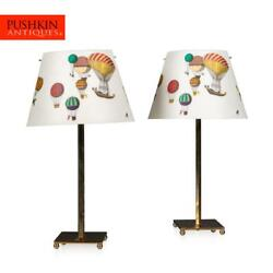 A Pair Of Late 20th Century Italian Side Lamps By Fornasetti