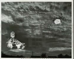 1964 Press Photo Witch And Her Broom Silhouetted Against A Cloudy Sky