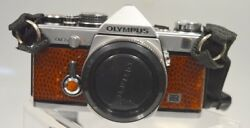 Olympus Om-2n Silver Camera Body With Medium Brown Leather-shows Some Wear.