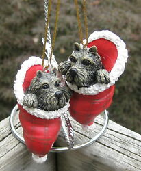 Pair of Scottie Dog Ornaments inside Santa's Hat