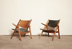 An original oak pair of Hans Wegner CH28 Sawbuck Armchairs, 1950/60s, Denmark