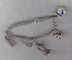 Nice Small Silver Charm Bracelet With Five Charms In A Used Condition