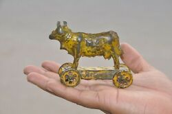 Vintage Yellow Litho Cow On Platform Tin Penny Pull Along Toy