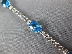 8.14ct Diamond And Aaa Blue Topaz 14kt White Gold 3d Oval And Round Tennis Bracelet