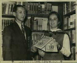 1968 Press Photo Aligers Library Staff Member Mary Corrier Accepts A Directory