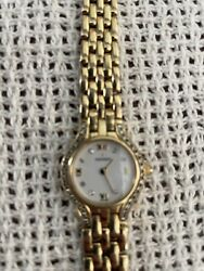 Movado Ladies 14k Solid Gold And Diamond Bezel Sapphire Crown Watch