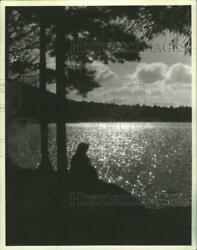 1983 Press Photo A Visitor Watches The Water At Plum Lake, Near Sayner