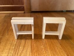 Two Breyer Saddle Stands