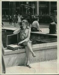 1967 Press Photo A Girl Uses A Portable Executive Telephone In New York City.