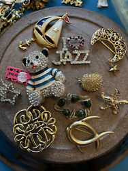 lot of great brooches some modern some vintage from quality estate.