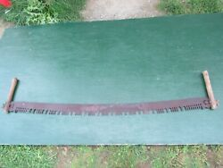 Vintage Crosscut Saw Tool Has Metal Blade With Two Wooden Handle