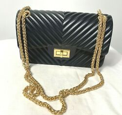 Details Nc Black Rubber Purse With Gold Chain Straps