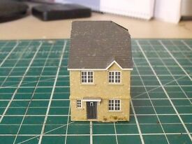 a small architectural model house built to 1