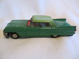 vintage 1960s cadillac tin friction toy car