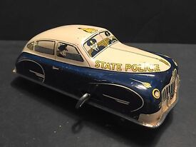 1950 s old tin wind up n j state police car