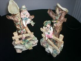pair of matching antique pottery figures