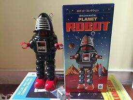 planet robot robby robot tin toy wind up