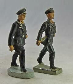 2 german figures black uniforms armbands