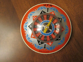 nice vintage ufo tin space roulette game