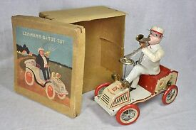 boxed 20s tut tut man toots horn driving car