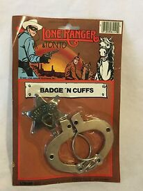 vintage lone ranger 1985 badge and handcuffs