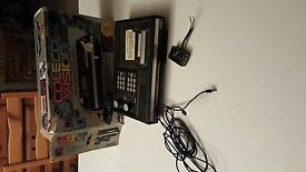 colecovision black console with several