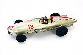 vintage japan 18 golden jet tin car