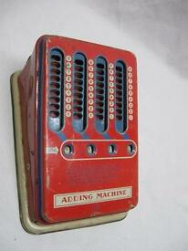 vintage tin toy mechanical adding machine by