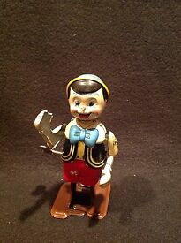 vintage linemar pinocchio wind up tin toy