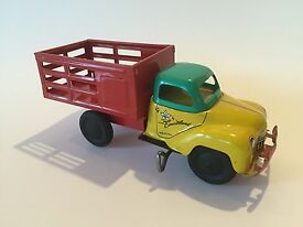 vintage toy wind up stake bed truck with