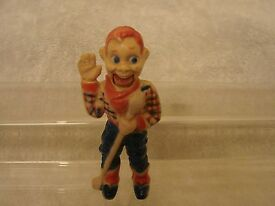vintage plastic figure with lever that moves