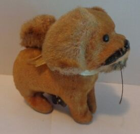 circa 1950 alps japan wind up toy dog w tail