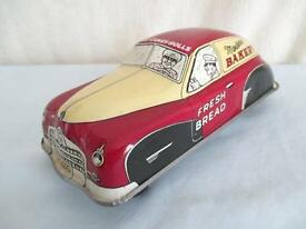 old tin bakery car vintage wind up toy