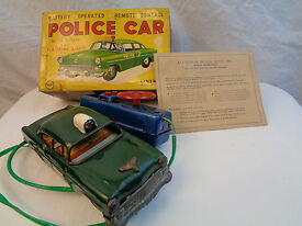 boxed vintage tin battery op police car by
