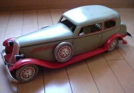 tin toy auto sedan made with a 1935 limited