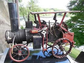 primitive 1910 toy steam engine tractor with