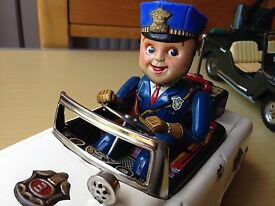 tn vintage tinplate battery operated police