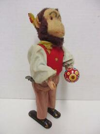 vintage tin monkey playing maracas wind up